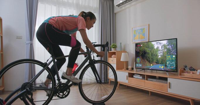 woman ride exercise bike