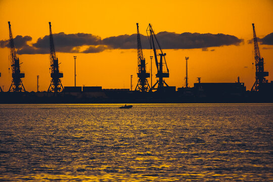 Silhouette Of Sailboats On Pier Against Sky During Sunset