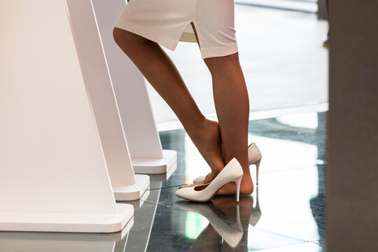 Russia. Saint-Petersburg. Participants of the St. Petersburg International Economic Forum. Women's feet without shoes.