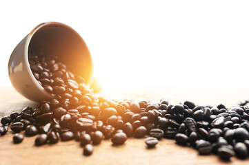 Coffee beans and hot coffee on the table roasted coffee beans background