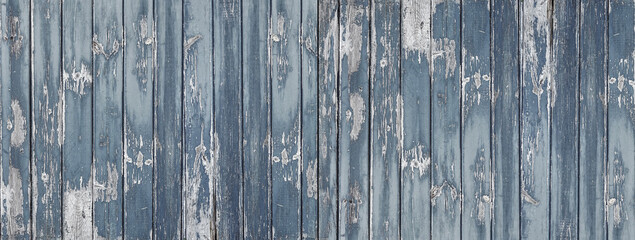Wooden fence in grunge style. The abstract background. Damaged surface with scratches and knots.