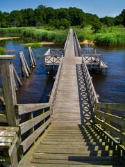 Fototapeta drewniany pomost na jeziorze lebsko Poland obraz