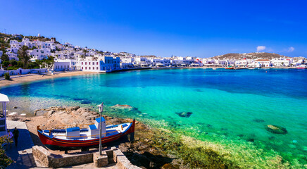 Mykonos island. Greece summer holidays. Panorama of old port in downtown with turquoise sea and beach. Cyclades.