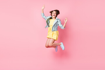 Photo of energetic lady open mouth jump look camera wear yellow mini dress shoes isolated pink color background Wall mural