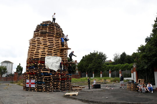 A contentious loyalist bonfire pyre is seen ahead of Twelfth celebrations, in Belfast