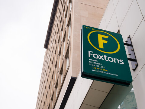 London, UK, July 2021: Foxtons West End Estate Agents, 137-144 High Holborn, London WC1V 6PL. Covering Holborn and surrounding areas. The green and yellow logo sign, left side copy text space.