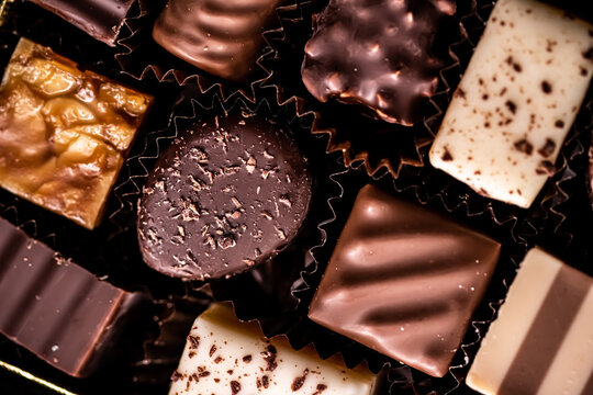 Swiss chocolates in gift box, various luxury pralines made of dark and milk organic chocolate in chocolaterie in Switzerland, sweet dessert food as holiday present and premium confectionery brand.