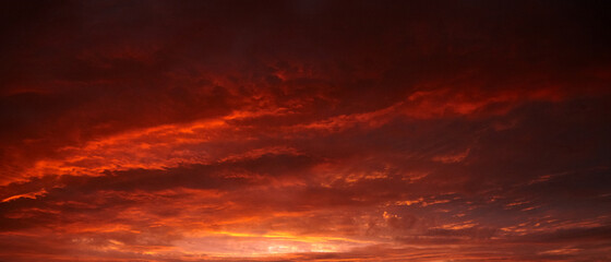 Fototapeta Red sunset sky with dramatic clouds obraz