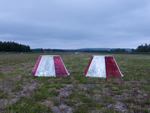 Barrier and warning cones on a grass airfield. Problem solving concept.Shot in Sweden, Scandinavia