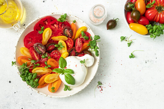 Salad with tomatoes and burrata cheese