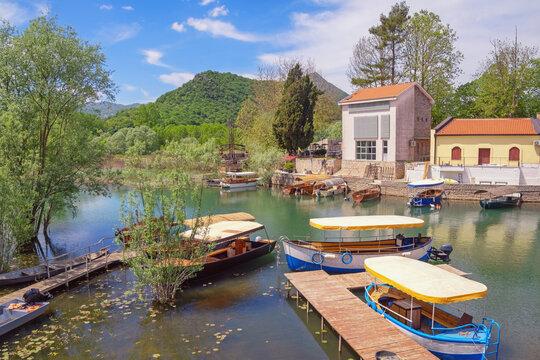 Montenegro. National Park Lake Skadar. Virpazar village  on sunny spring day. Tourist boats on river