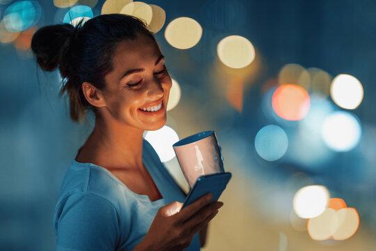 Woman using phone late at night