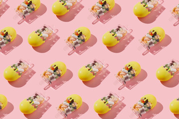 Pattern of plastic ice creams filled with pills and drugs on pastel pink background. Remedy for...