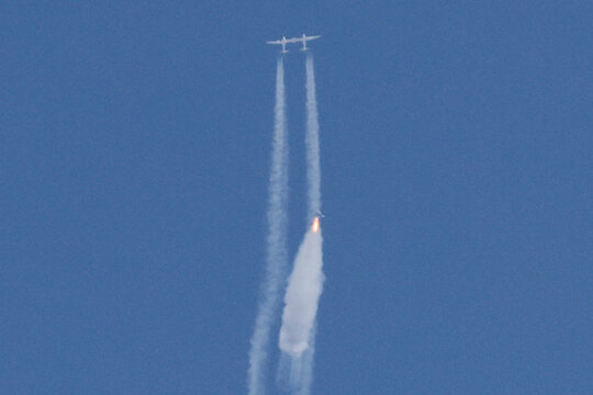 Virgin Galactic's passenger rocket plane VSS Unity begins ascent to the edge of space above Spaceport America