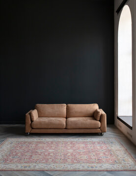 Comfortable sofa with pillows in the interior of a spacious living room, real photo with copy space on an empty black wall