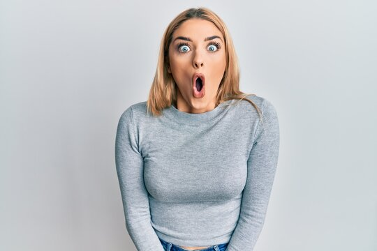 Young caucasian woman wearing casual clothes afraid and shocked with surprise expression, fear and excited face.