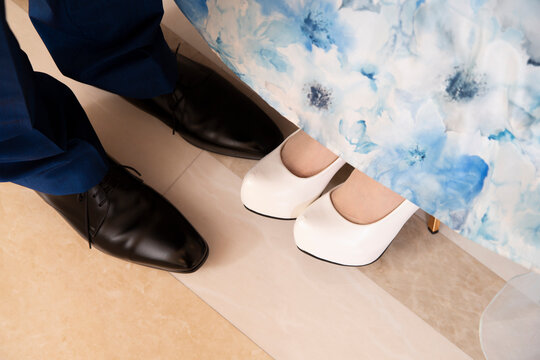 Bride and groom costumes and shoes