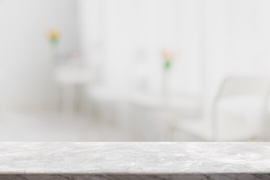 Empty white marble stone table top and blur glass window interior restaurant banner mock up abstract background - can used for display or montage your products.