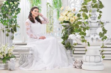 Fototapeta portrait of young beautiful bride in white dress posing obraz