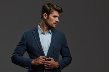 Fototapeta Profile of young focused european business man obraz
