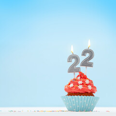 Obraz Christmas card with cupcakes, and new year 22 candles - fototapety do salonu