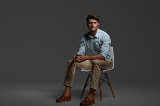 Serious european business man sitting on chair