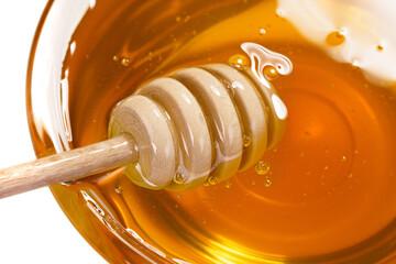 Obraz Miód pszczeli w słoiku na białym tle - fototapety do salonu
