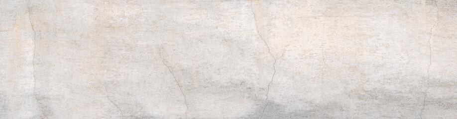Fototapeta Panorama Detail einer alten hellen Wand mit Rissen im verwitterten Verputz obraz