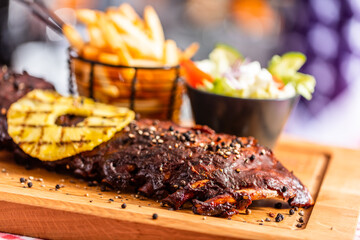 Ribs with salad and french fries in american restaurant