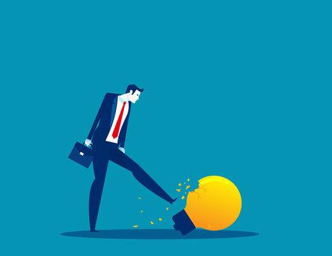 A businessman kicking a broken light bulb. Thinking that doesn't work
