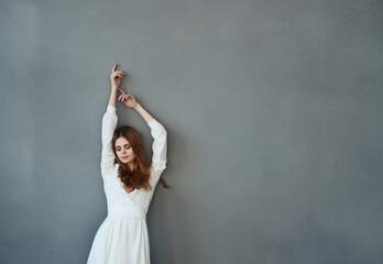 Obraz Woman in white dress fashion glamor and luxury posing - fototapety do salonu