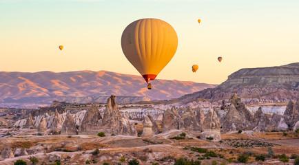 Hot air balloons flying on sunset sky in Cappadocia, Turkey