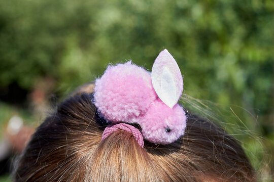 Pink cute fluffy bunny accessory for hairpin close-up.