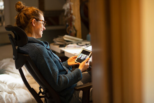 Woman working from home video chatting with coworkers digital tablet