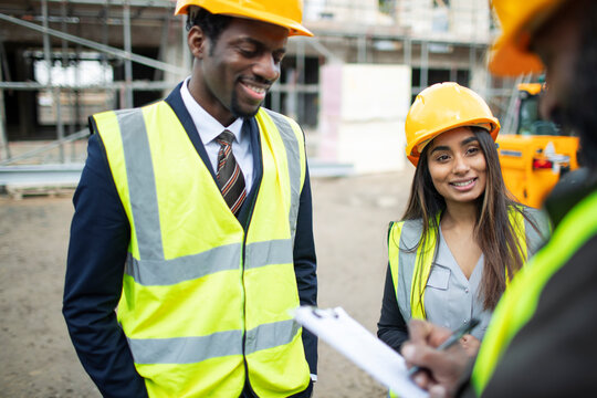 Architects and foreman talking at construction site