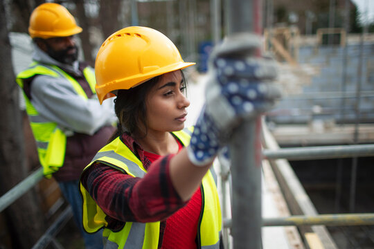 Thoughtful female construction worker at construction site
