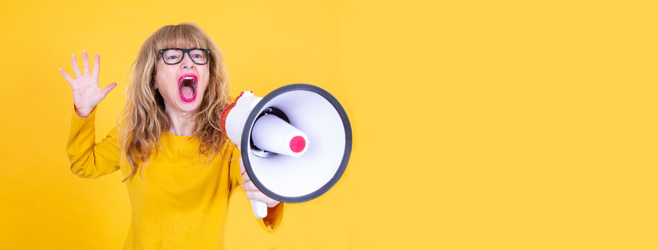 woman shouting with megaphone isolated