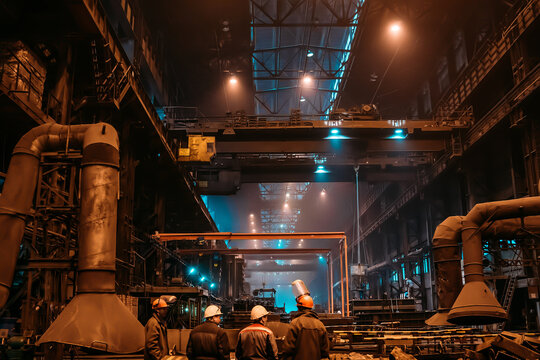 Foundry workshop. Metallurgical plant with unrecognizable workers. Heavy industry background.