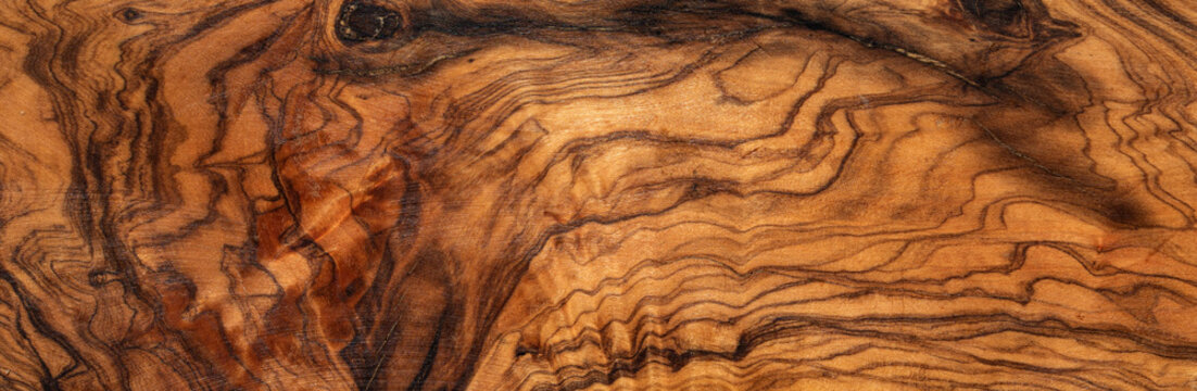 texture of dark brown olive wood plank. background of wooden surface