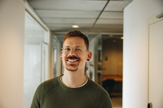 Portrait of happy male executive in office