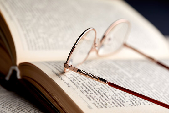 glasses on the book pages