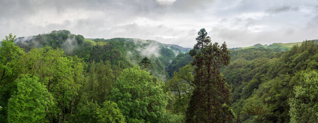 Fototapeta Panorama of Welsh mountains and wooded valley of River Mynach. obraz