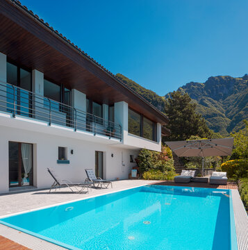 Modern two-story house with large pool overlooking the mountains