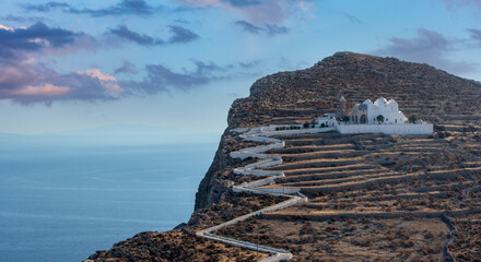 Obraz Folegandros island, Greece, Cyclades. Panagia Virgin Mary Church and long zigzag road.. - fototapety do salonu