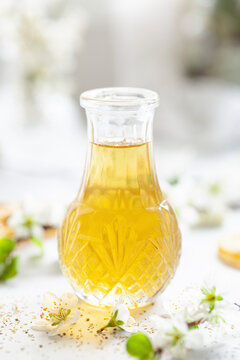 A small bottle filled with camomile tea syrup