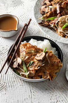 Egg Foo Young with Rice and chopsticks