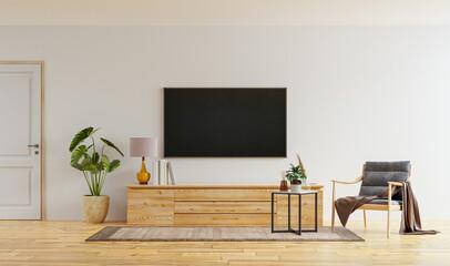 Fototapeta Smart TV on the white wall in living room with armchair,minimal design. obraz