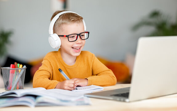 Cheerful boy during online lesson at home