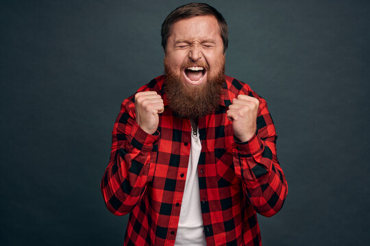 Overjoy, success and life goals concept. Ecstatic pleased and delighted good-looking man scream from happiness, heard great news, achieve success, winning, become champion, got reward