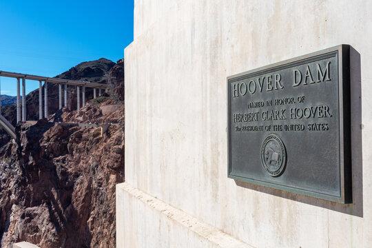Hoover Dam memorial plaque in honor of President Herbert Hoover. Mike O Callaghan Pat Tillman Memorial Bridge. - Boulder City, Nevada, USA - 2020